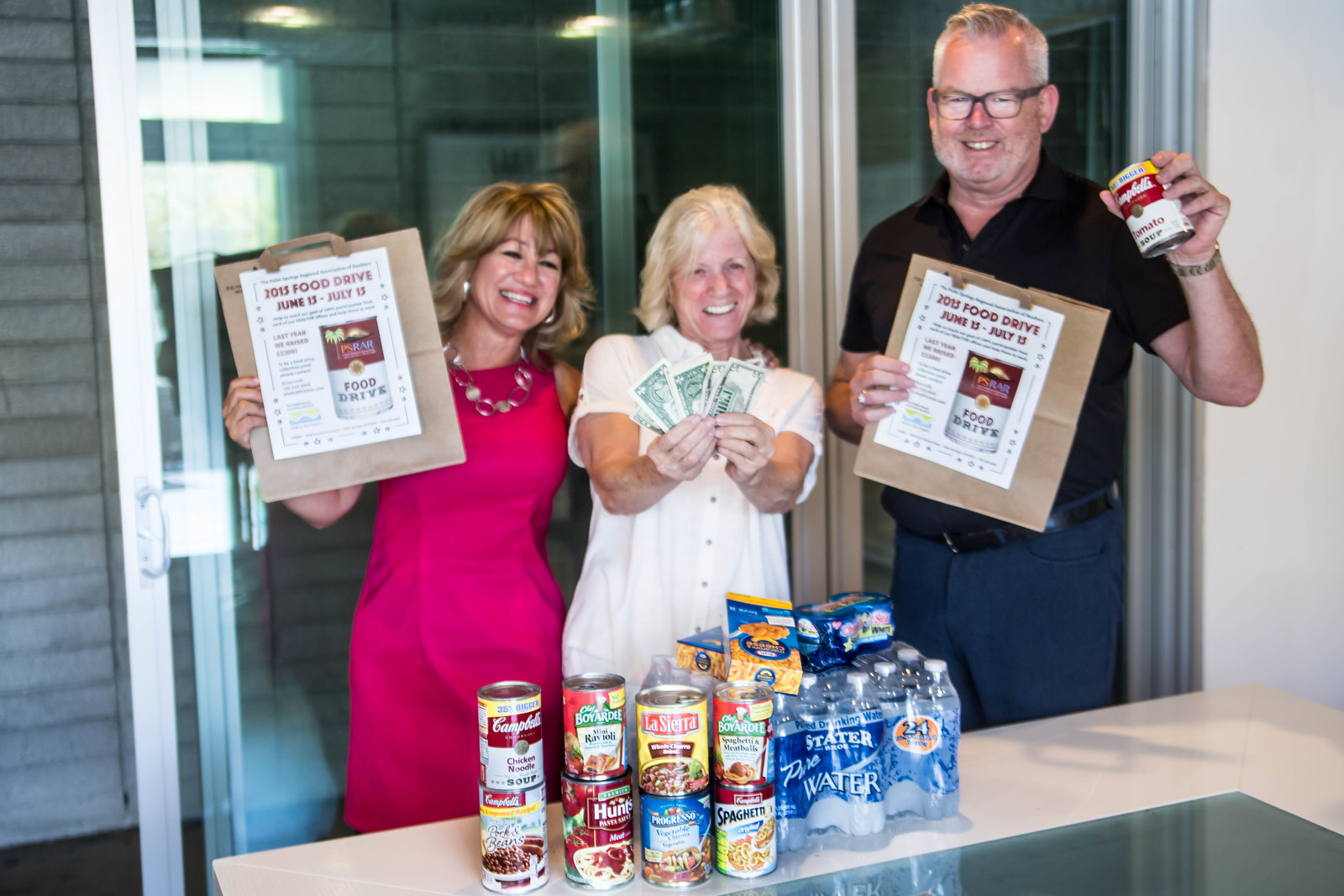 Members of the Palm Springs Regional Association of Realtors Food Drive Committee: Debra Comer of Acme House Co., Melinda