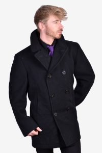 Vintage Sterlingwear Of Boston pea coat oat in a black colour. Double breasted six anchor button front. Twin waist pockets, mid vent reverse and classic sailor collar. Made from a wool fabric and fully inside lined. Label reads 44R.