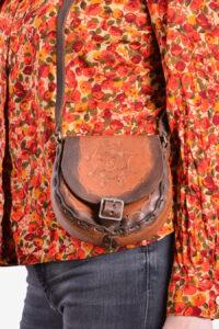Vintage small tooled leather saddle bag