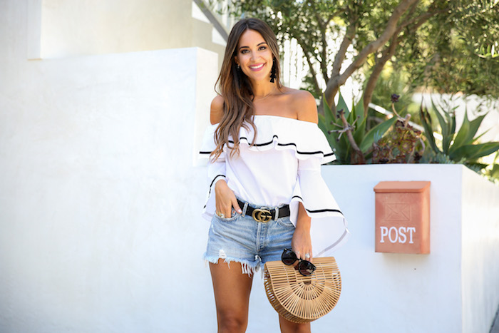 white bell sleeved off the shoulder top