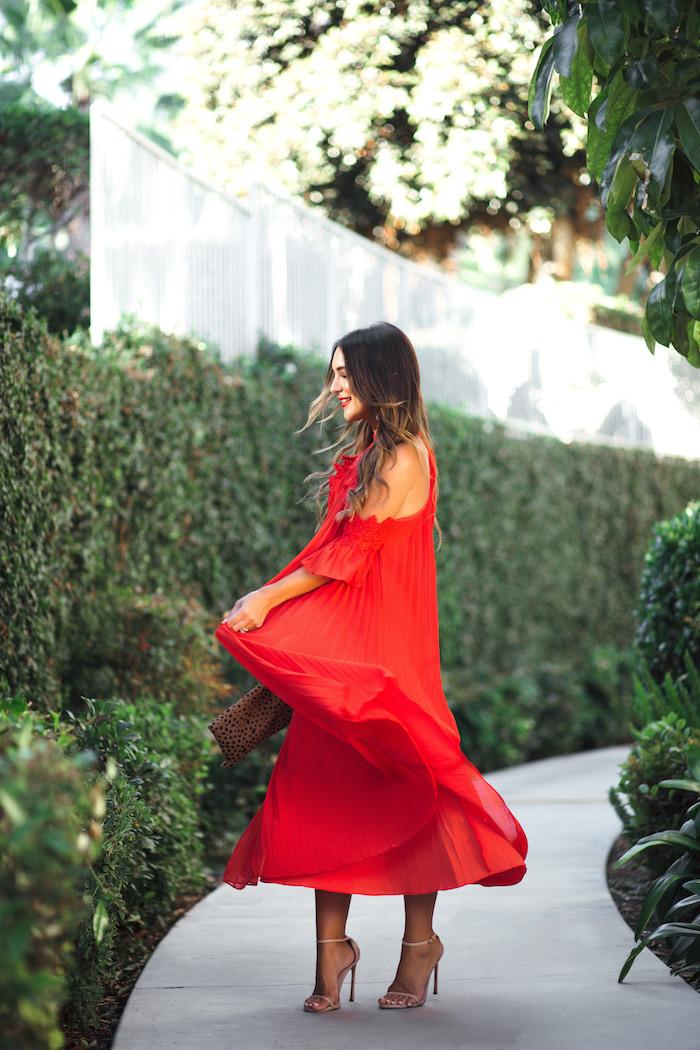 twirling red midi dress
