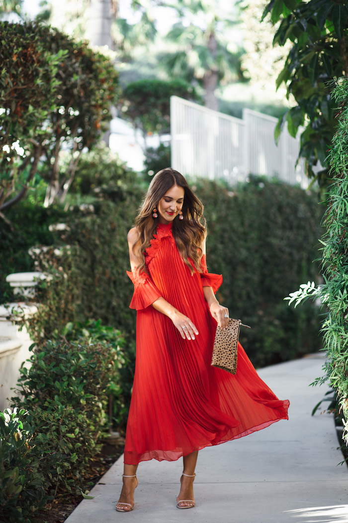 red pleated midi dress with leopard purse