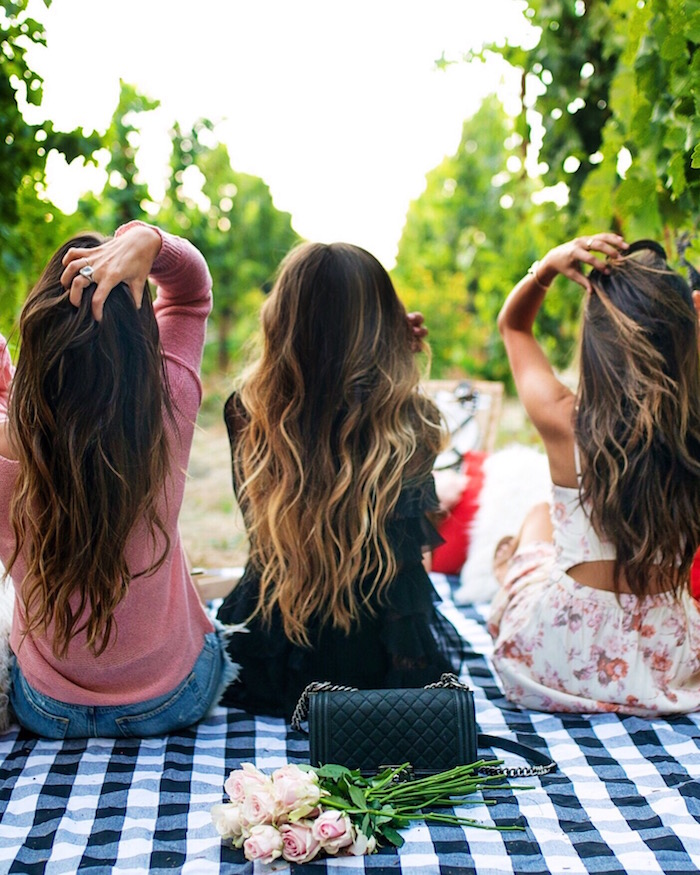 three girls with long brown hair