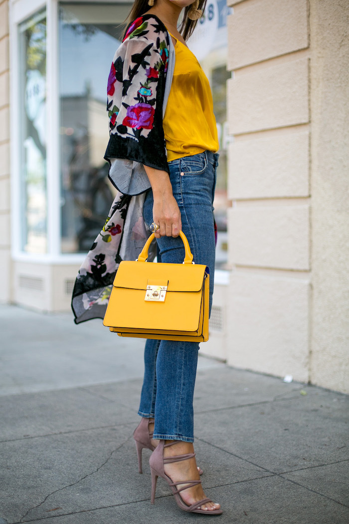 yellow top handle purse