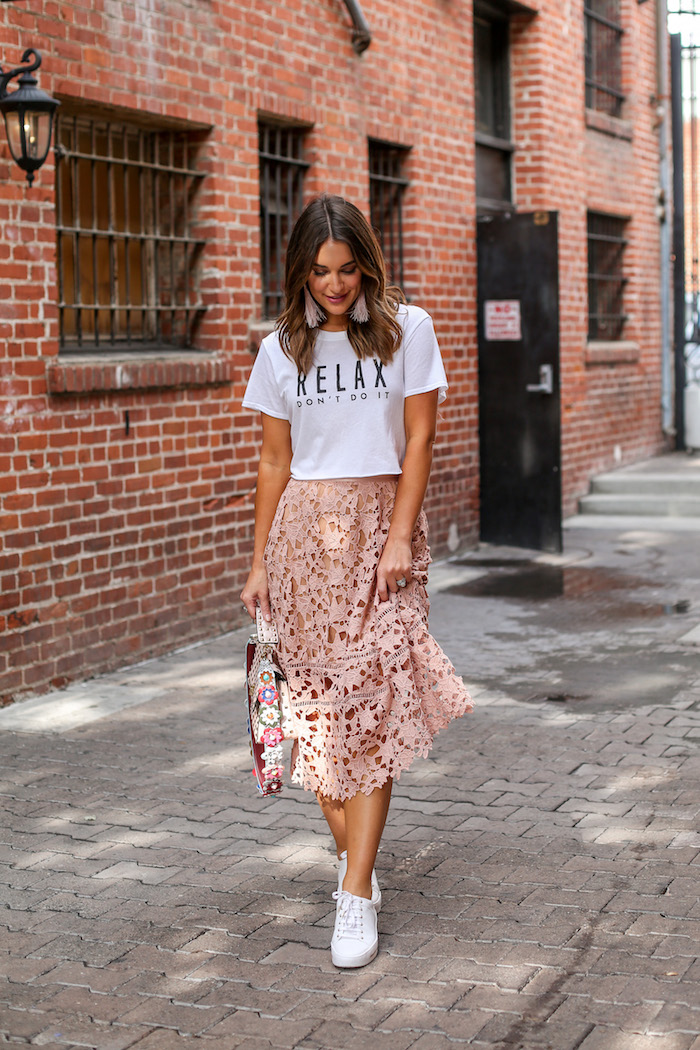 wearing a skirt with sneakers