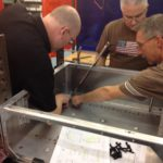 Engineers Inspecting Welded Sheet Metal Fabrication
