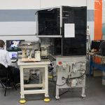 Engineer testing and debugging automation machine in PEKO's NPI and Development Division
