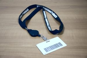 Employee badge with clearly marked PEKO lanyard for identification and access into building