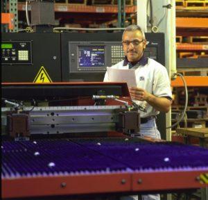 Engineer setting up CNC machine