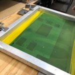 silk screen placed over metal part