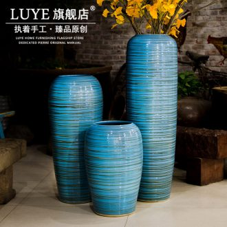 Big blue vase landed sitting room lobby flower arranging place large household adornment to heavy clay ceramic vase