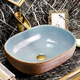 Ceramic sink on stage basin oval plate of the pool that wash a face Chinese creative household toilet bathroom art