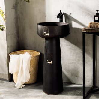 Black ceramic column type lavatory basin of wash one hotel pool simple small hotel floor of the basin that wash a face