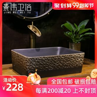 The stage basin to black stone carving art ceramic rectangle retro sinks the trumpet on the sink