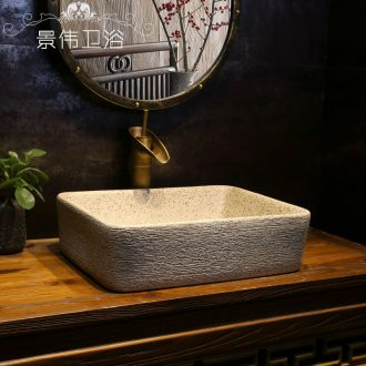 Archaize grind arenaceous grain art stage basin rectangle ceramic lavatory basin of Chinese style household on the sink