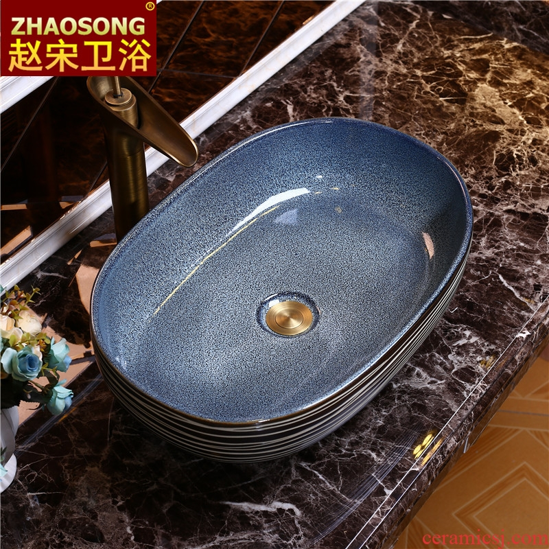 European stage art basin to large-sized ceramic table toilet lavabo oval face basin basin 60 cm