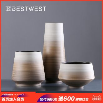 Designer duds ceramic vase is placed between example soft adornment creative dry flower vase porcelain light luxury living room