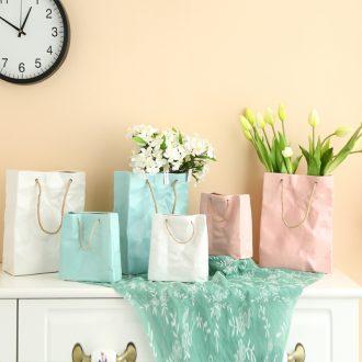 Creative handbag ceramic vases, ceramic furnishing articles furnishing articles simulation flower dried flower flower implement ceramics art ornaments