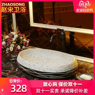 Wash basin on the ceramic basin sink more oval ceramic art basin of household of Chinese style water basin