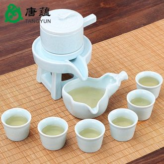 Tang, the accumulate half automatic kung fu tea set ceramic household lazy creative tea teapot teacup of a complete set of millstones