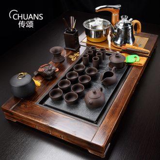 Famed domestic solid wood tea tray automatic electric tea stove of a complete set of ceramic tea set kung fu tea set