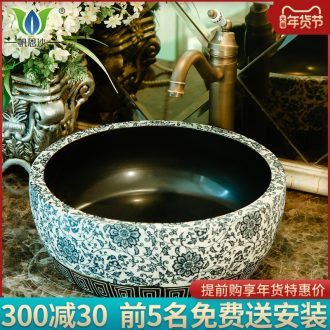 On the ceramic art basin circular lavatory basin round basin toilet water basin the sink of the basin that wash a face