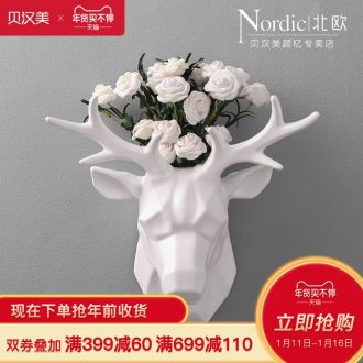 Creative home wall decoration decoration I and contracted deer head hanging of pottery and porcelain brought flowers decorate the sitting room porch flowers on the wall