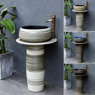 The Nordic pillar type lavatory is suing floor ceramic wash basin balcony garden bathroom sink