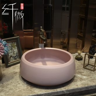 On the pink ceramic POTS round European art basin sink basin bathroom sinks counters are contracted
