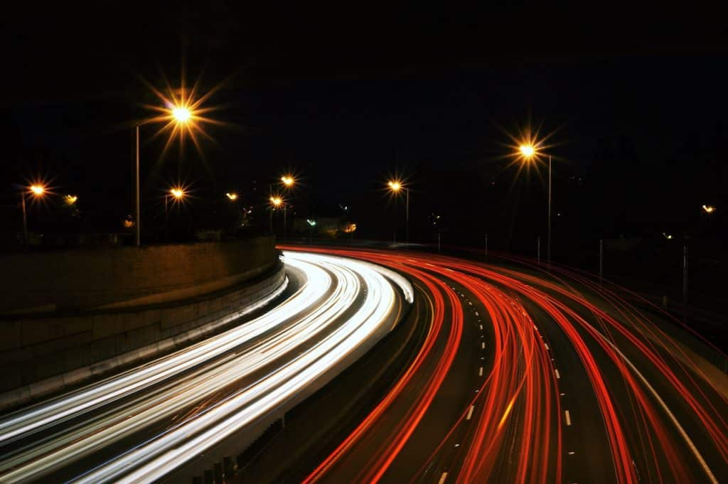 A busy highway with a lot of cars