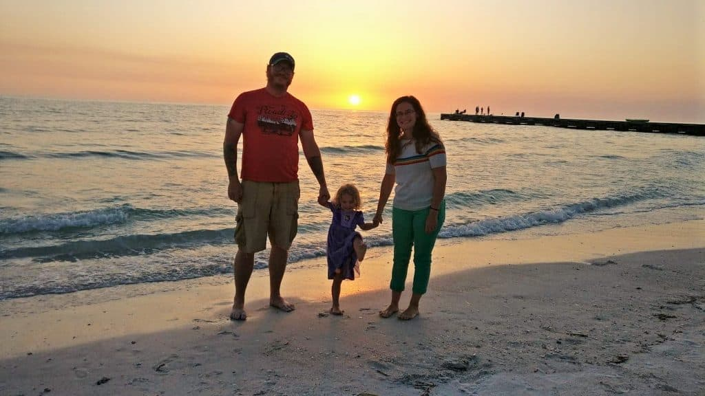 family at beach in fort de soto campground