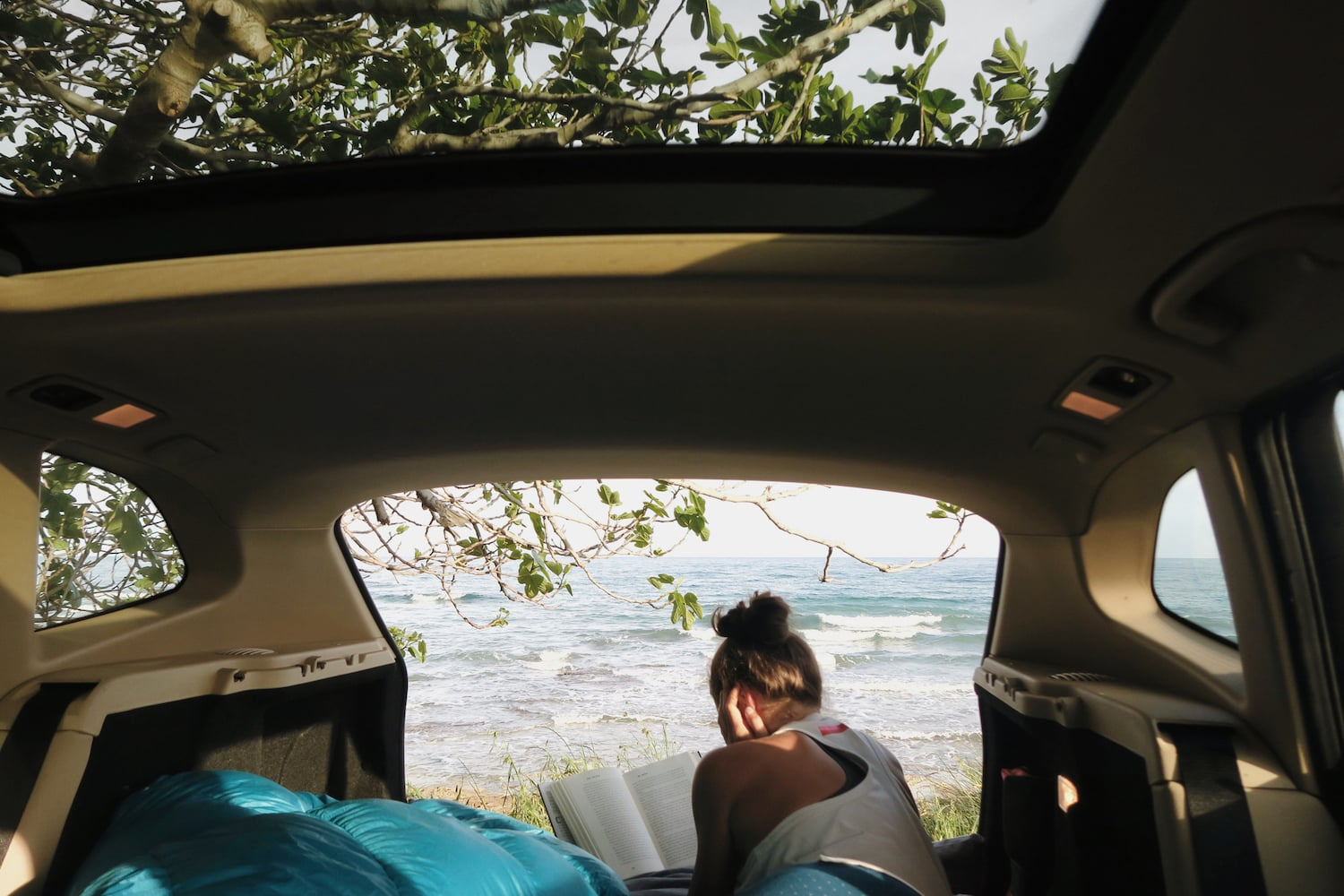 A woman living a minimalist life in a van