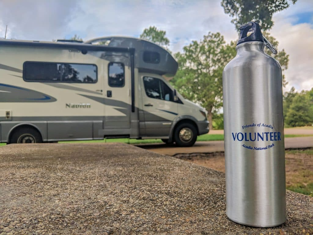 volunteer waterbottle with RV in the background