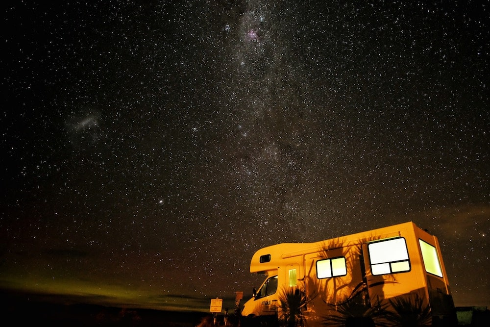 RV parked under a starry night sky