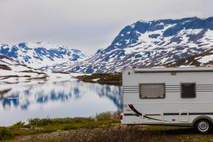 A camper parked in a snowy landscape that needs a space heater inside