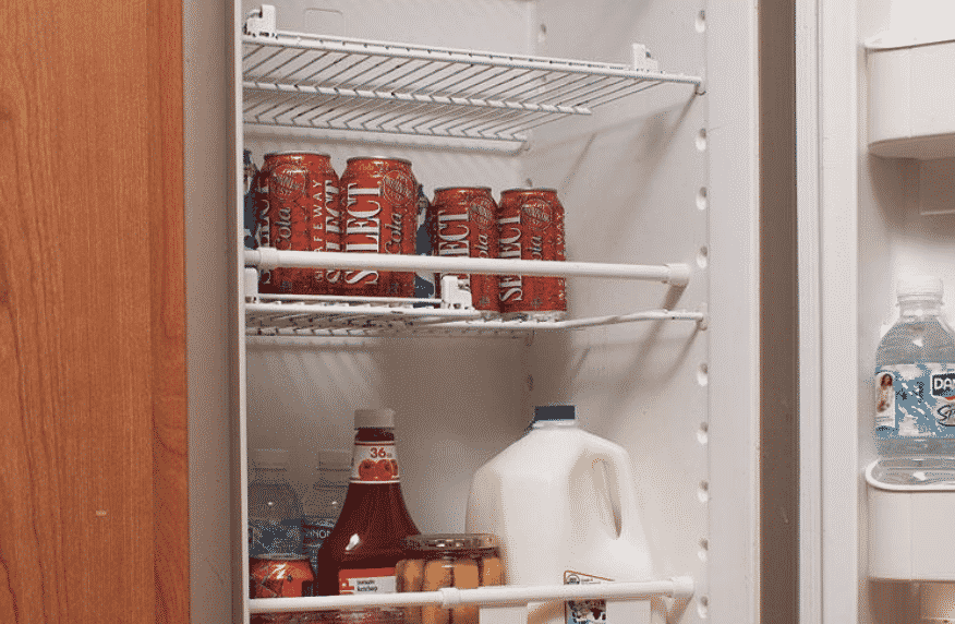 Refrigerator bar holding back soda cans