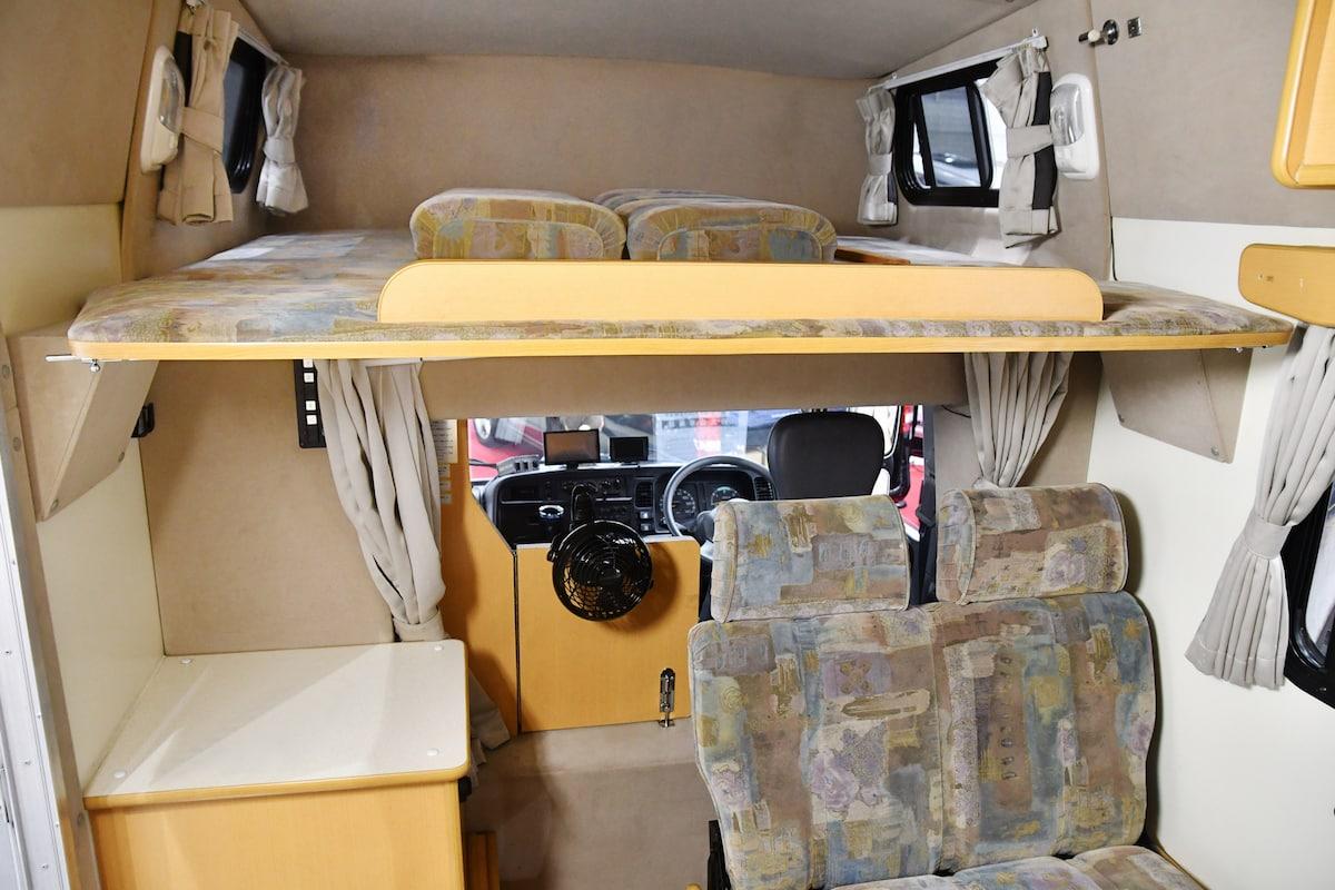 Sleeping area over cab
