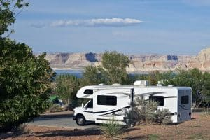 RVing in Arizona. Class C Recreation Vehicle with Opened Side Slider in Page, Arizona, USA. Glen Canyon Recreation Area / Lake Powell. Recreation Photo Collection. (RVing in Arizona. Class C Recreation Vehicle with Opened Side Slider in Page, Arizona,