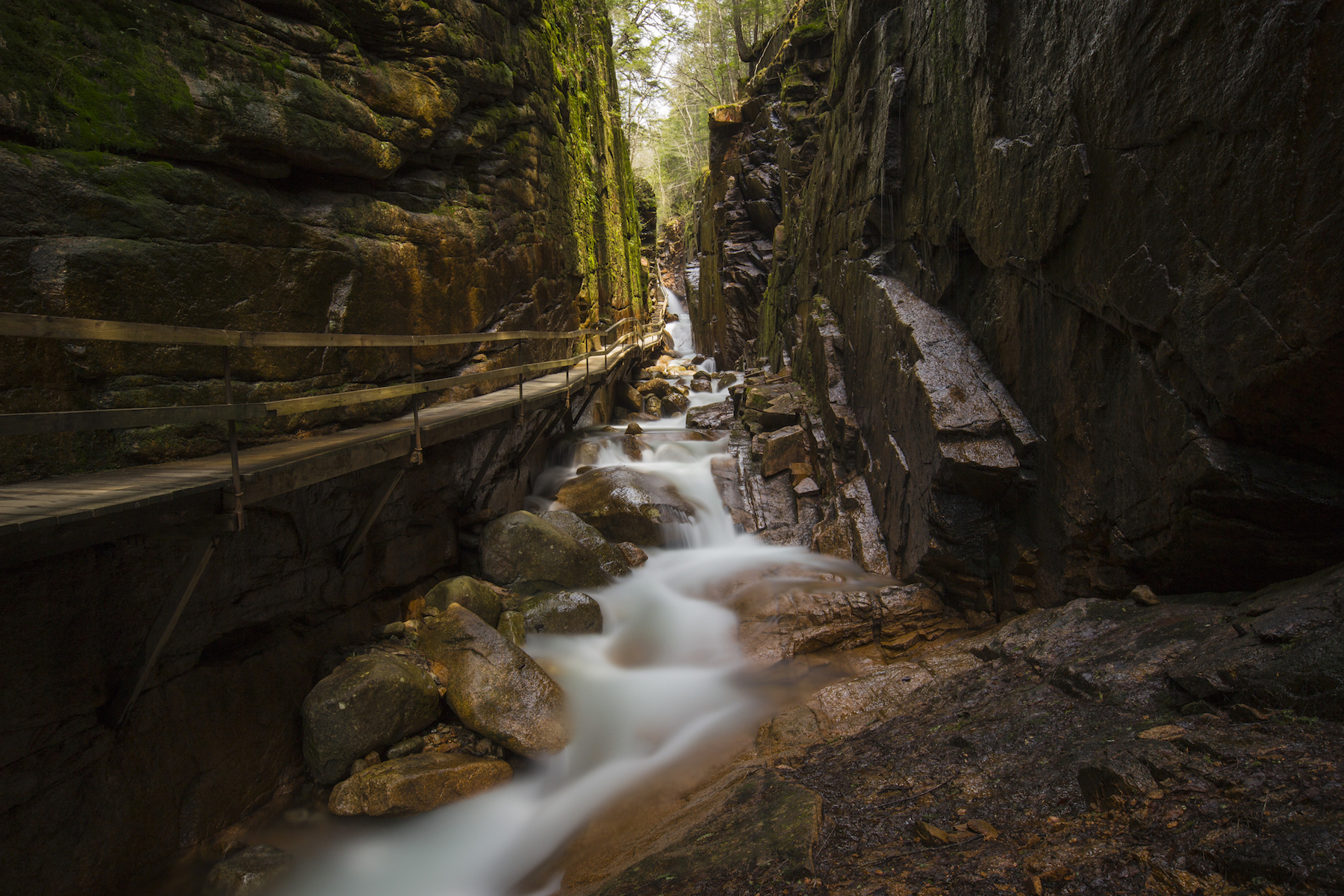 The water flowing beside a wooden walkway in the Flume Gorge in Franconia Notch State Park.