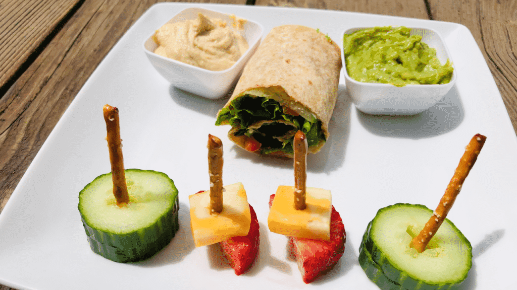 Rainbow veggie wraps can be sliced into small servings to making eating on the go simple. Simply roll thinly sliced veggies on your wrap of choice with a little guacamole, hummus, or cream cheese to hold it all together.