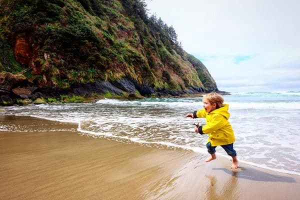 kid on a beach in Oregon
