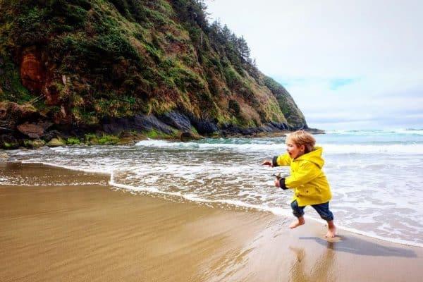 kid on a beach in Oregon
