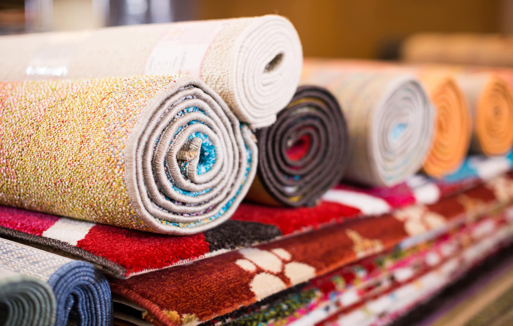 Stack of traditional colorful carpets and rugs