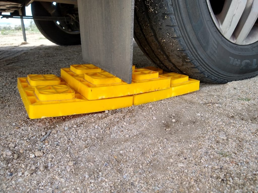 some leveling blocks close to an RV tire