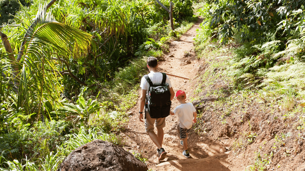 A man and his son on a hiking trail.
