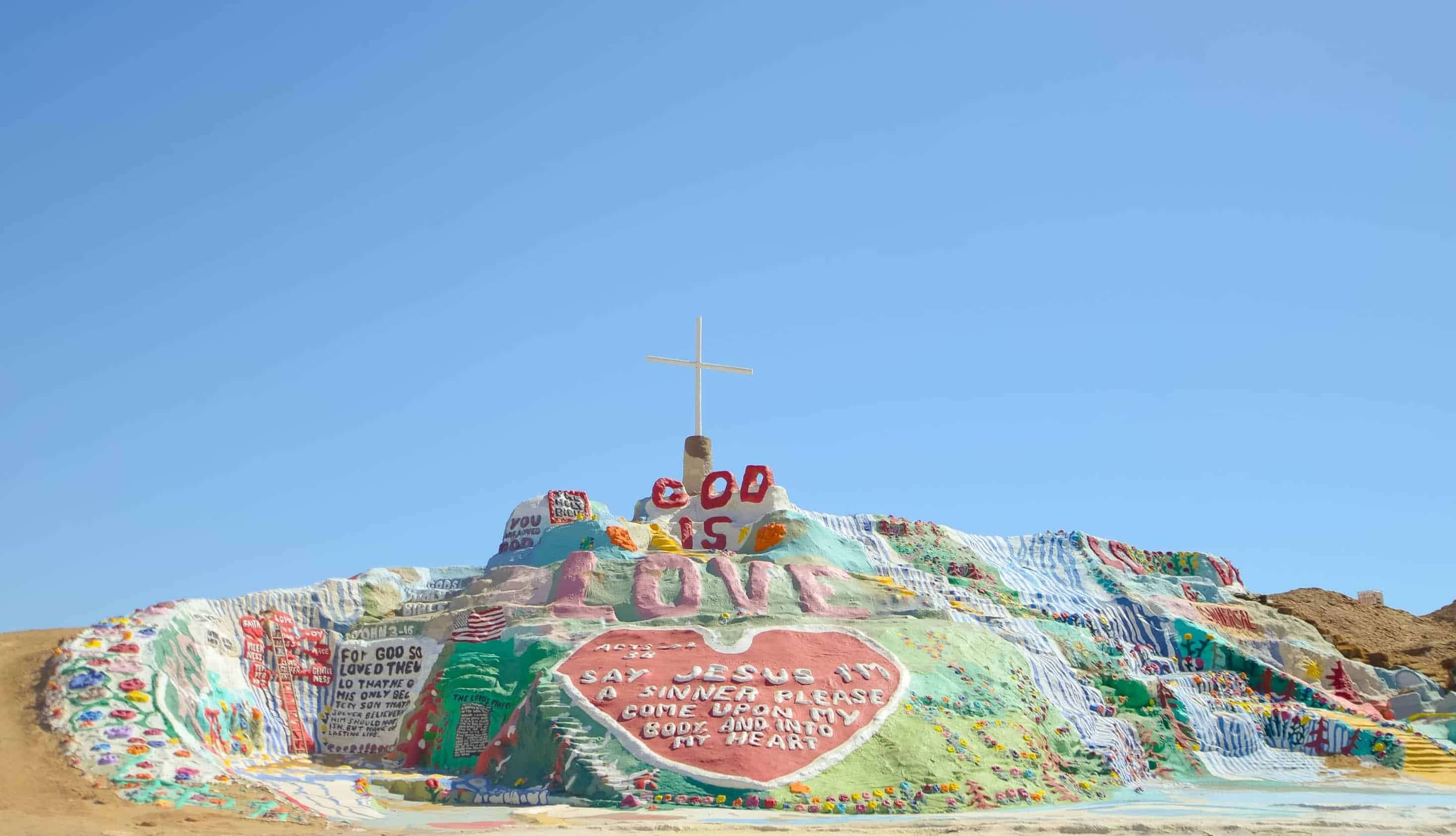 Salvation Mountain on a bright, sunny day in the Sonoran Desert