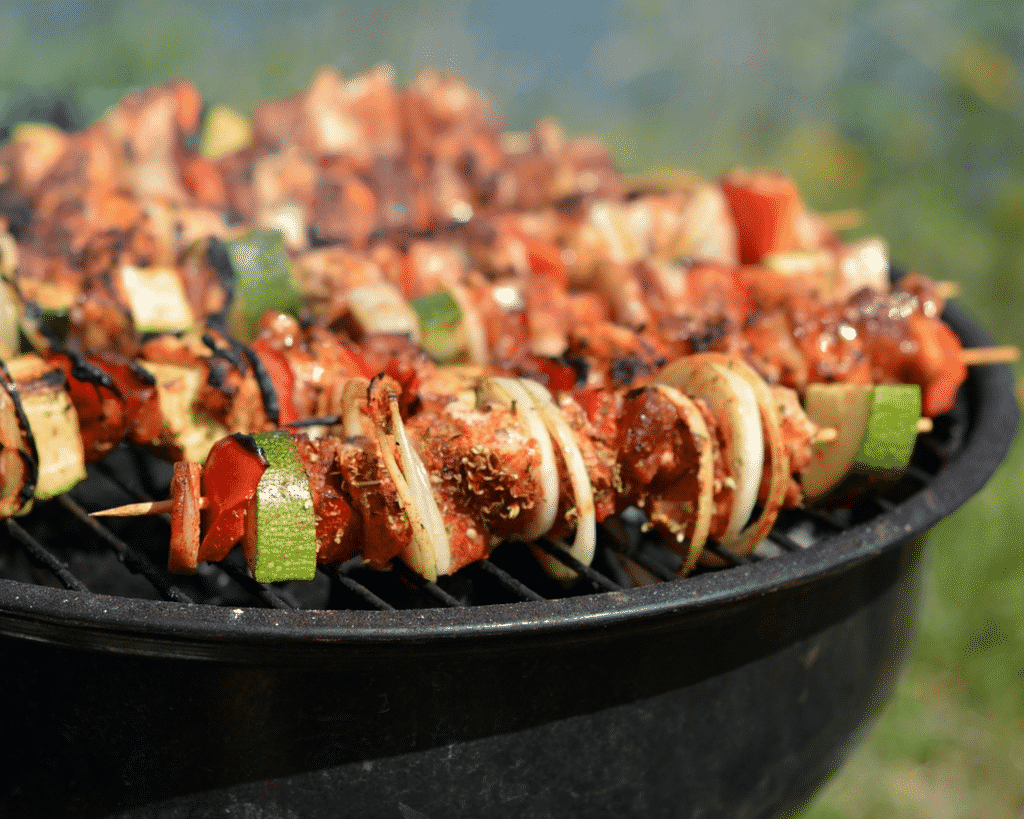 Chicken kabobs on a charcoal grill.