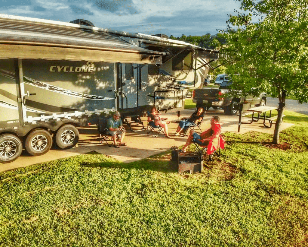 Campers socializing in front of RV