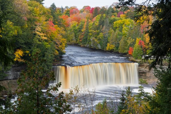 Seen here with colorful fall foliage, Michigan's Tahquamenon Falls is the second largest water fall east of the America's Mississippi River. (Seen here with colorful fall foliage, Michigan's Tahquamenon Falls is the second largest water fall east of t