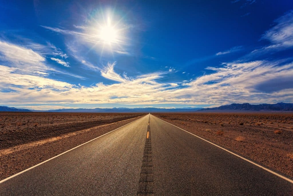 sun beating down on a road